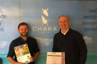 Chaka Travel receiving their corporate membership certificate
