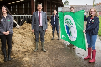 Lisnamurrican YFC receiving their green flag award from Minister Poots