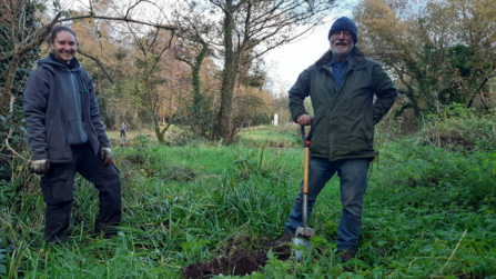 Laia and Phil tree planting at Balloo Woodland